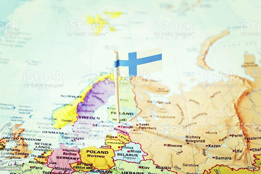 Finnish flag pinpoints Helsinki, Finland, on European map stock photo