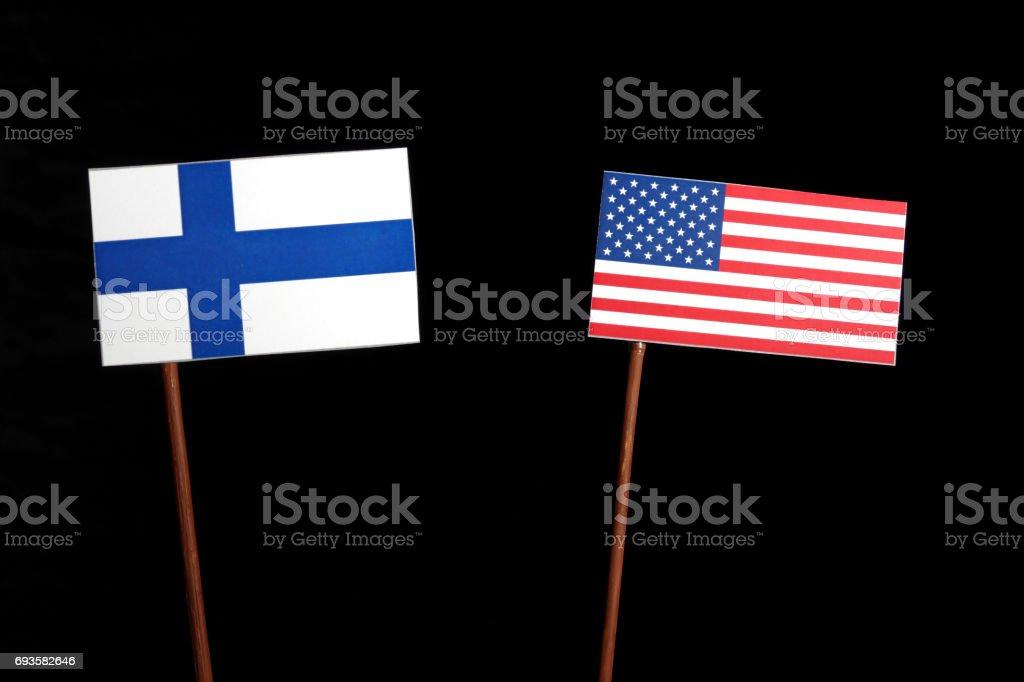 Finnish flag with USA flag isolated on black background stock photo
