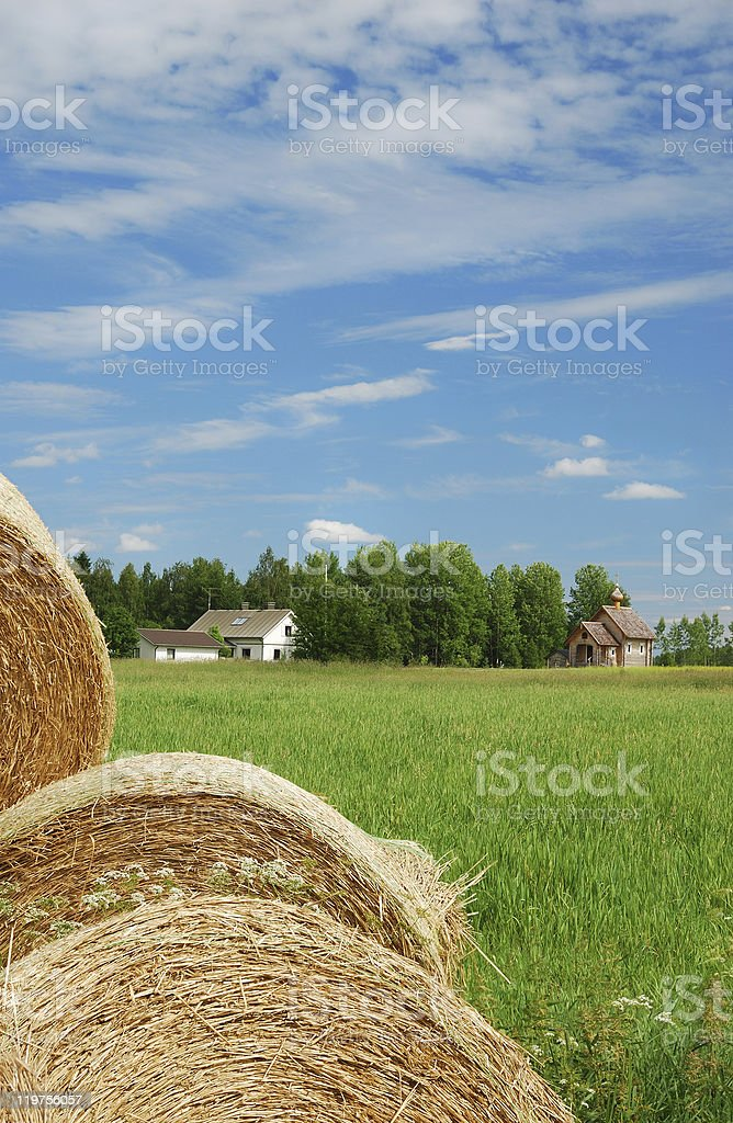 Finnish landscape with straw, farm and country church stock photo