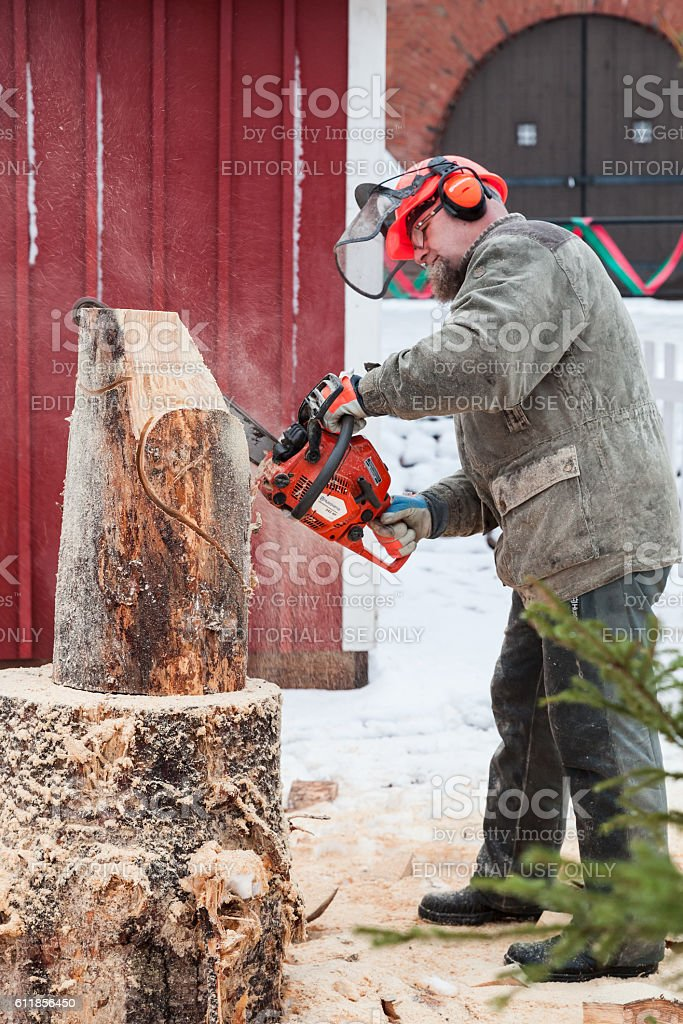 Finnish master sculptor with a chainsaw stock photo