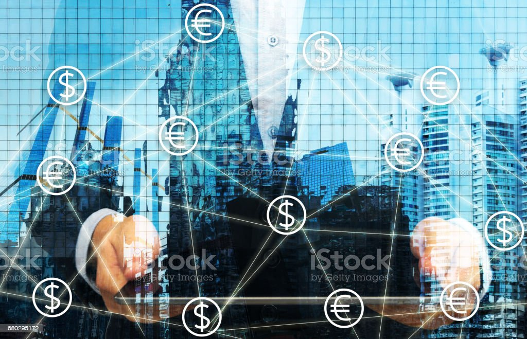 Fintech concept image. Currencies sign icon and Peer-to-peer icon with man suit holding tablet abstract and building background. stock photo