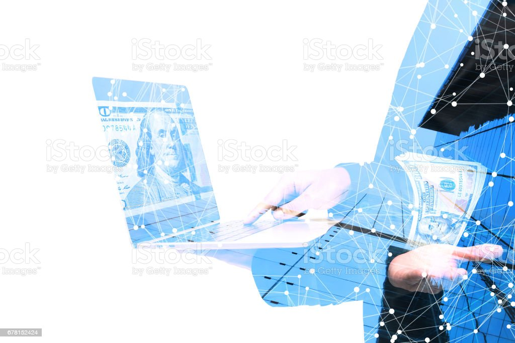 Fintech Investment Financial Technolog , P2P Payment ,Startup and crowd funding concept.Social network connect with P2P lending.Business man point finger to computer laptop and dollar popup from hand. stock photo