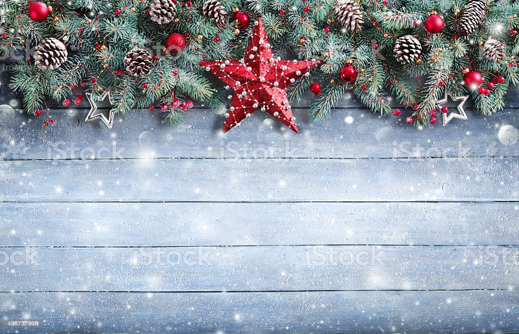 Fir Branch And Decoration On Snowy Plank stock photo