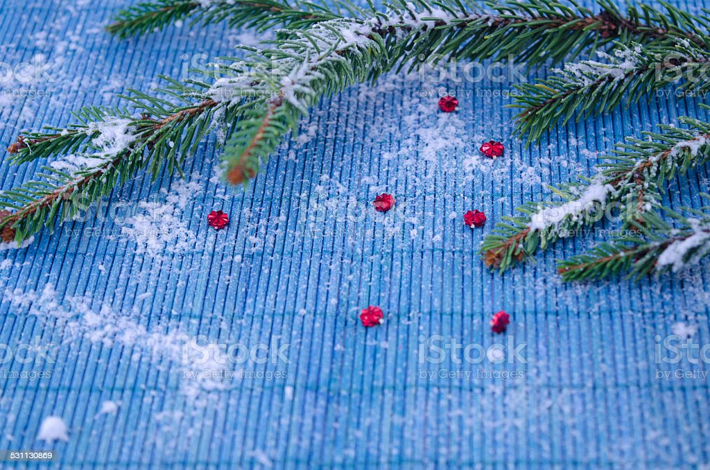 Fir branch and red stars covered with snow royalty-free stock photo