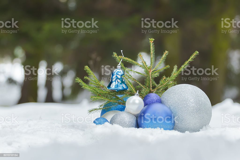 Fir sapling tree with Christmas silver and ornaments at bottom stock photo