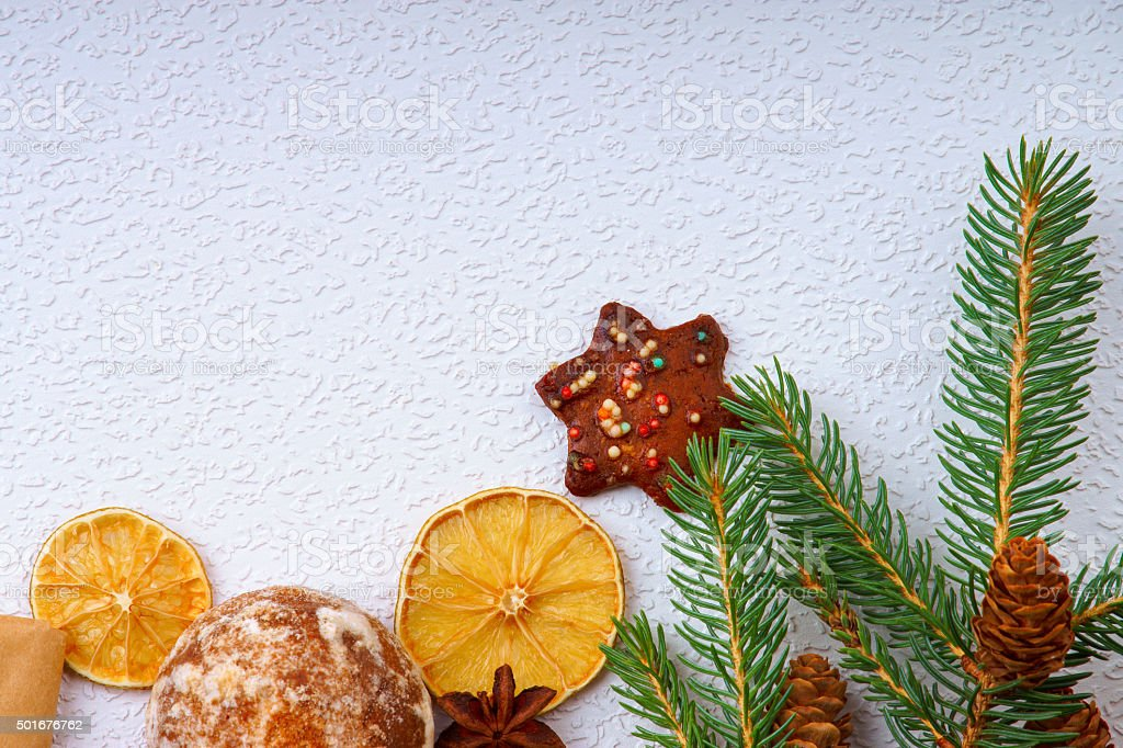 Fir tree branch, cookies, dried fruits and anise stock photo