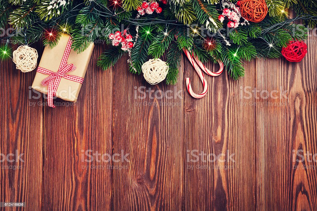 Fir tree branch with christmas lights, gift box stock photo