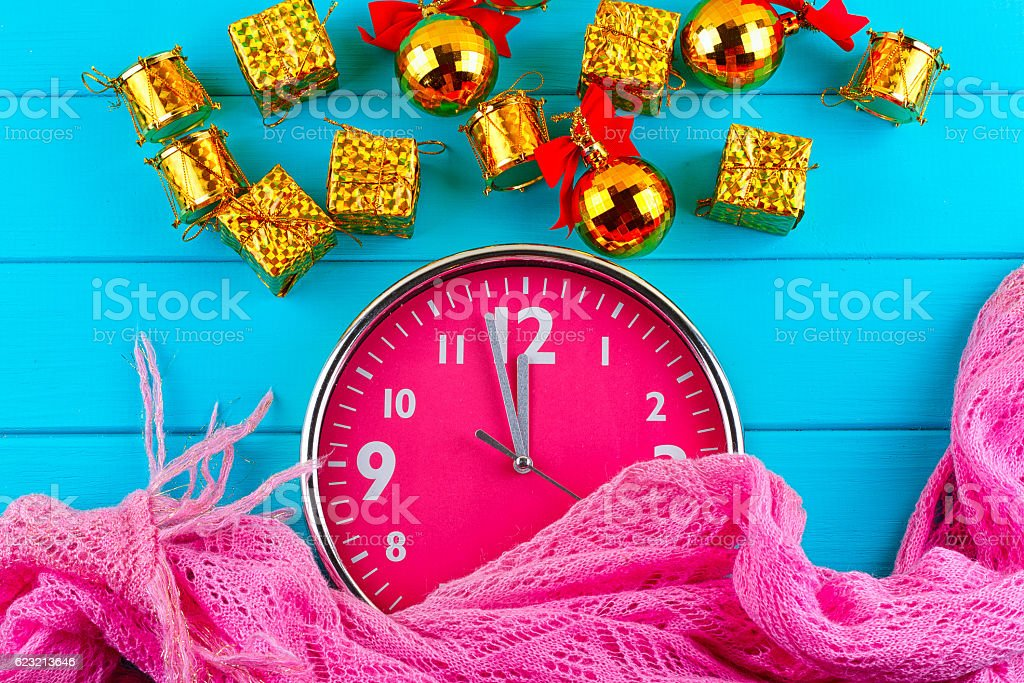 Fir tree with christmas decorations, alarm clock and gift stock photo