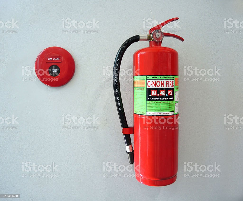 fire alarm and fire extinguisher stock photo