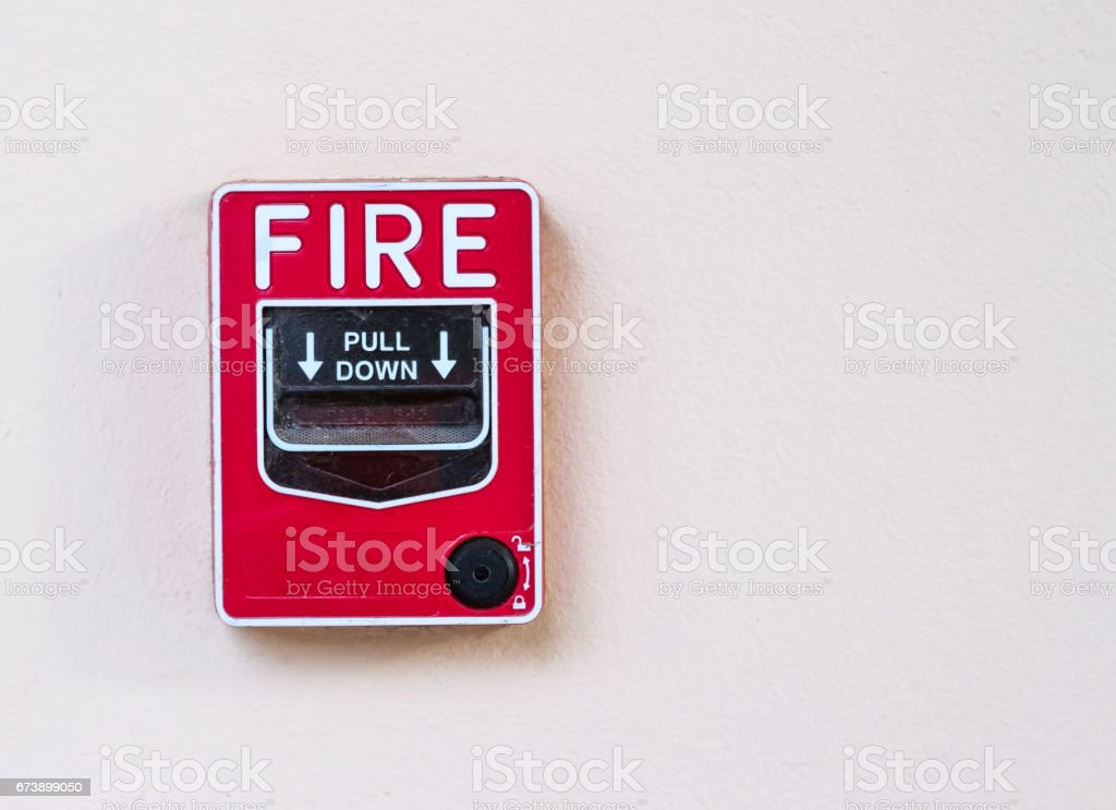 fire alarm box on cement wall for warning and security system stock photo