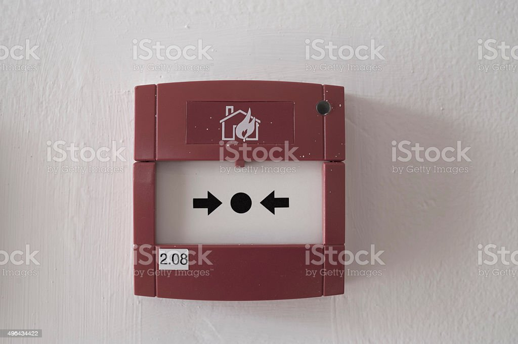 fire alarm box on cement wall for warning stock photo