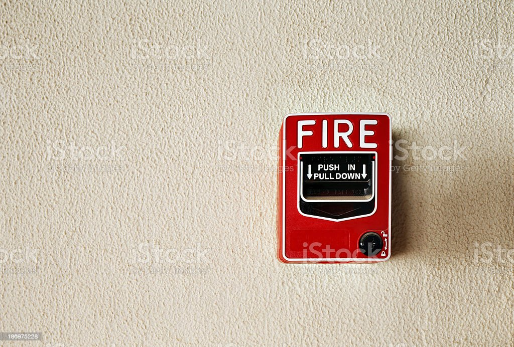 Fire alarm button on a wall stock photo