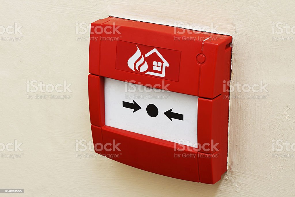 Fire alarm button on wall stock photo