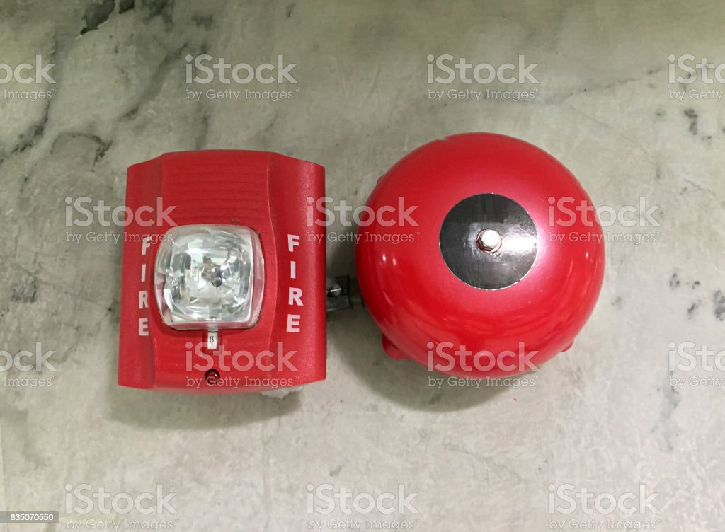 Fire Alarm red color on the marble wall. stock photo