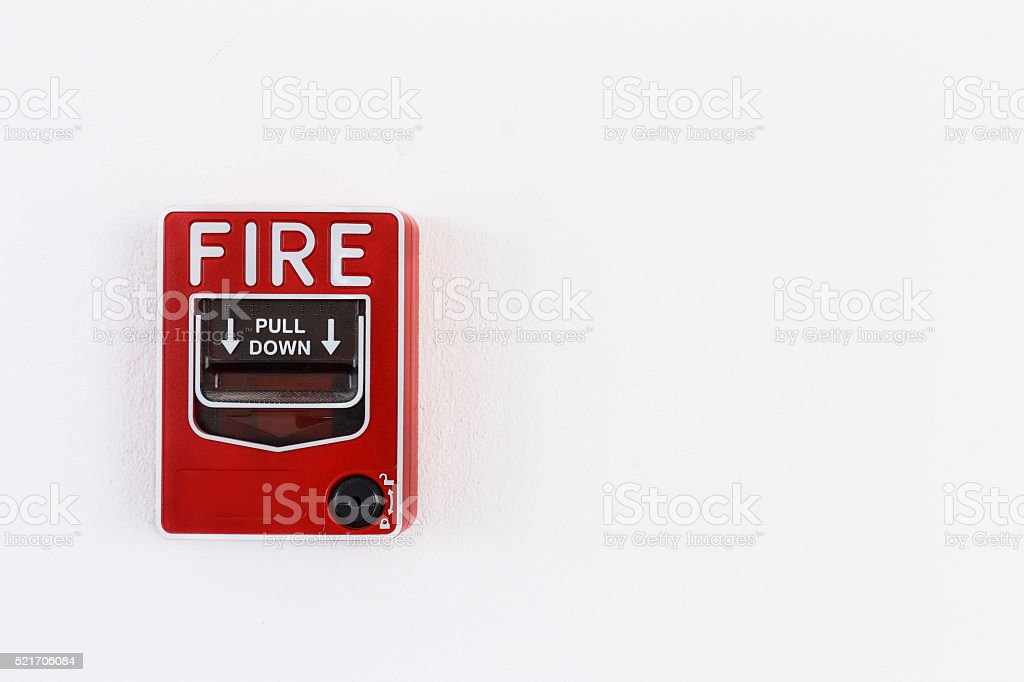 Fire alram pull switch on the white wall stock photo