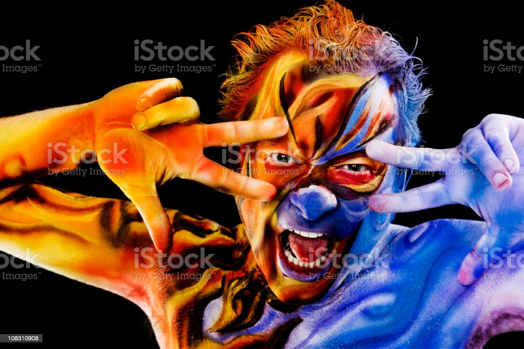 Fire and Ice Body Art on Man stock photo