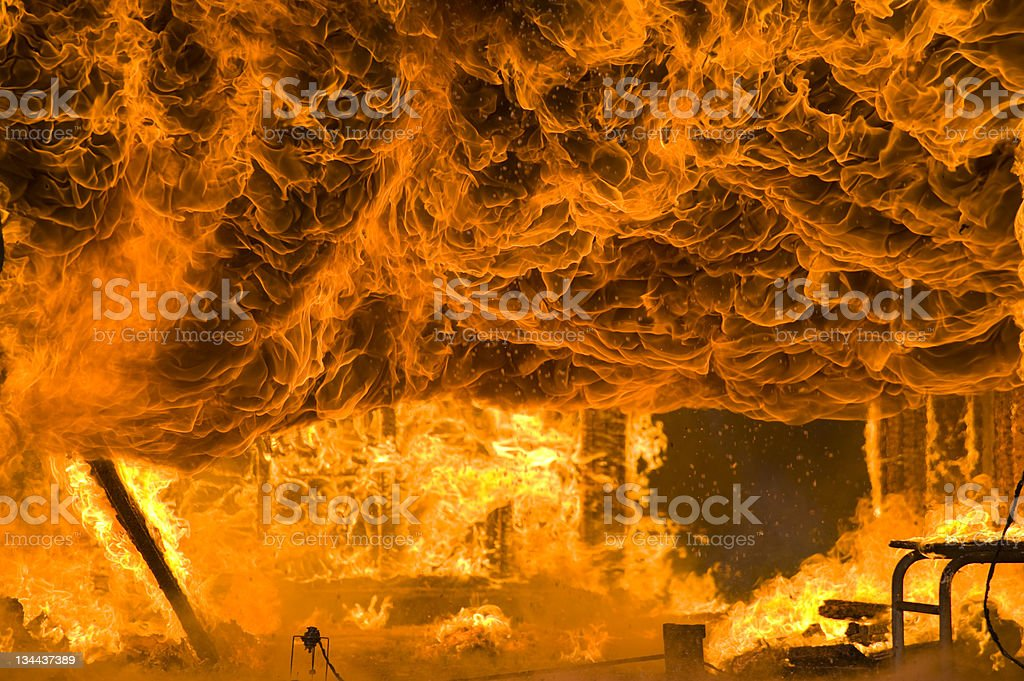 Fire and Intense Flames Burns Home to the Ground stock photo