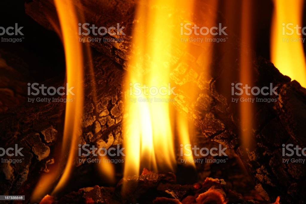 fire and logs in fireplace closeup royalty-free stock photo