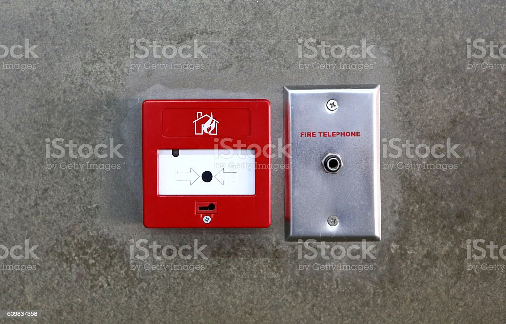 Fire break glass Fire alarm in the alarm on wall stock photo