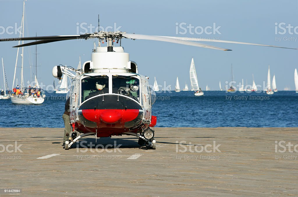 Fire brigade helicopter and Barcolana regatta-Trieste royalty-free stock photo