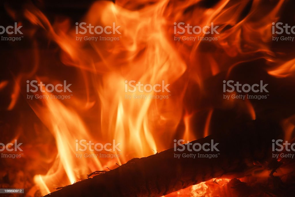 Fire burning bright orange and red in close up stock photo