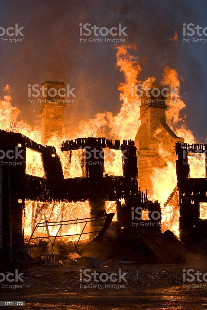 A fire burning down an establishment  royalty-free stock photo