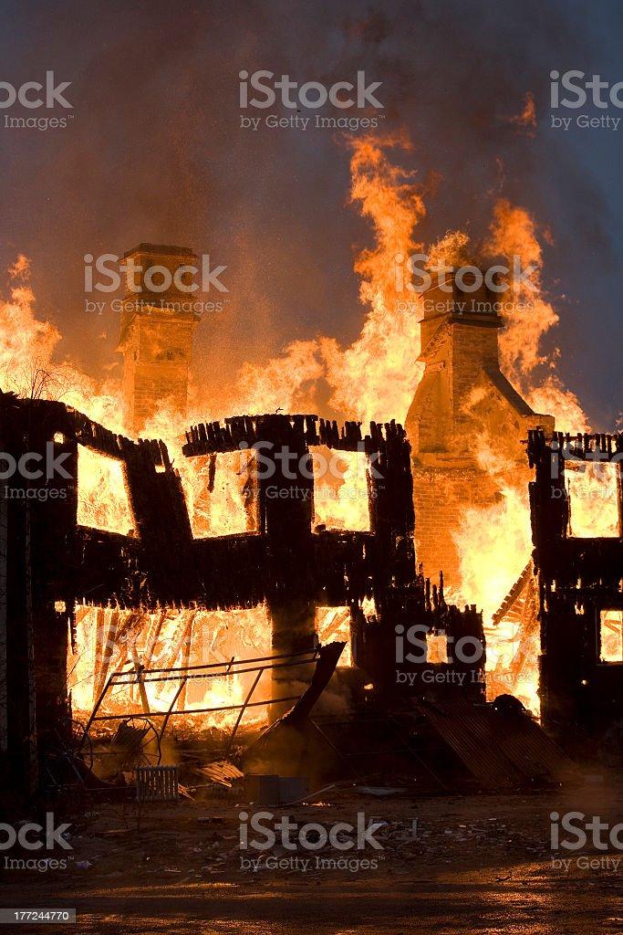 A fire burning down an establishment  stock photo