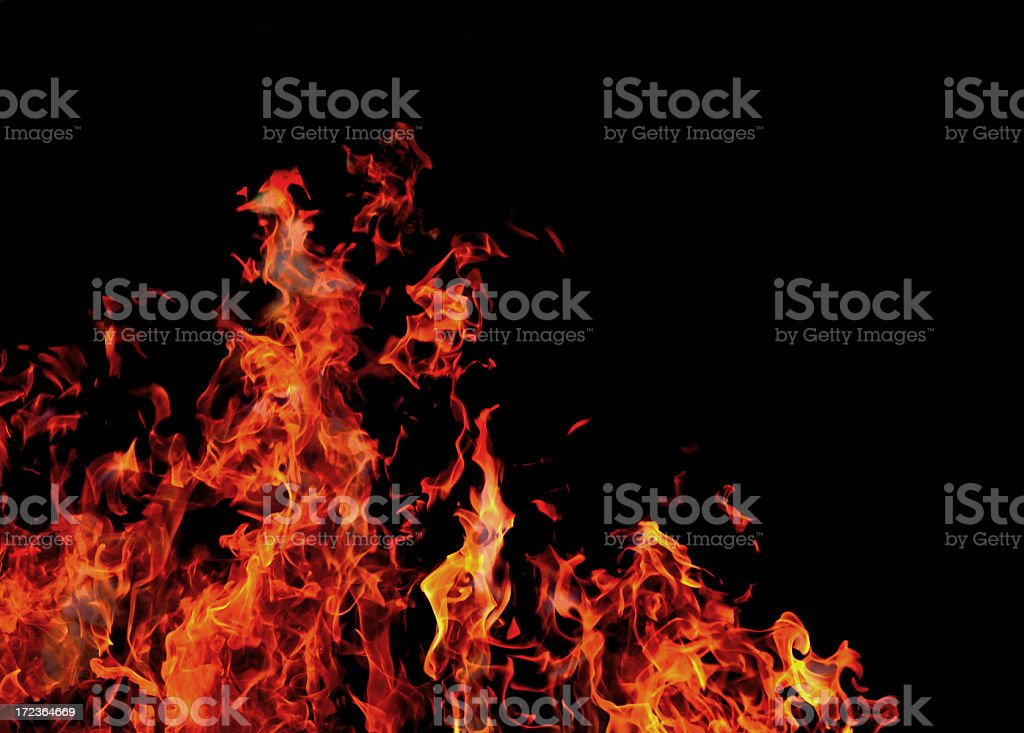 fire burning in front of a black background royalty-free stock photo
