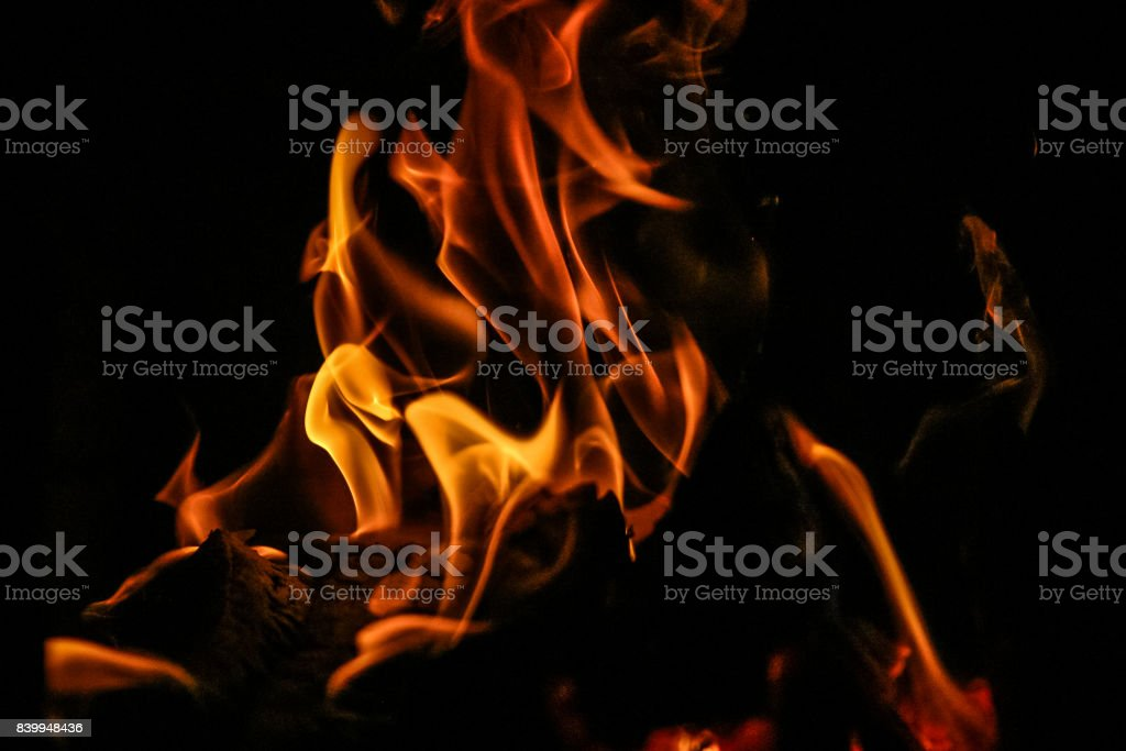 Fire burning inside a brick stove - wood, ash, flames. stock photo