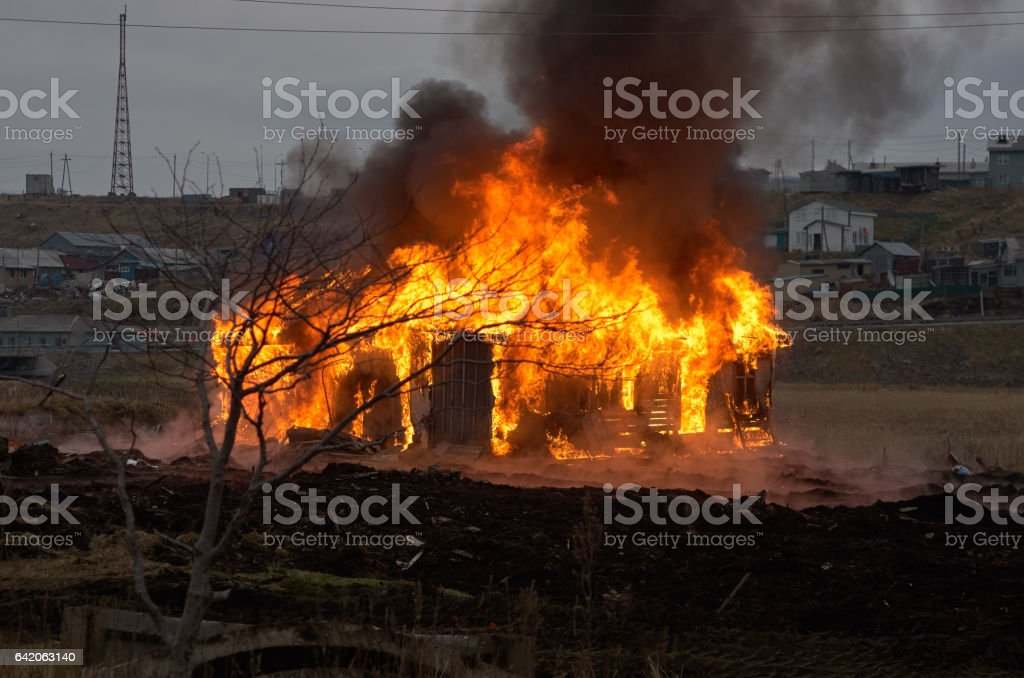 Fire. Burning old wooden house stock photo