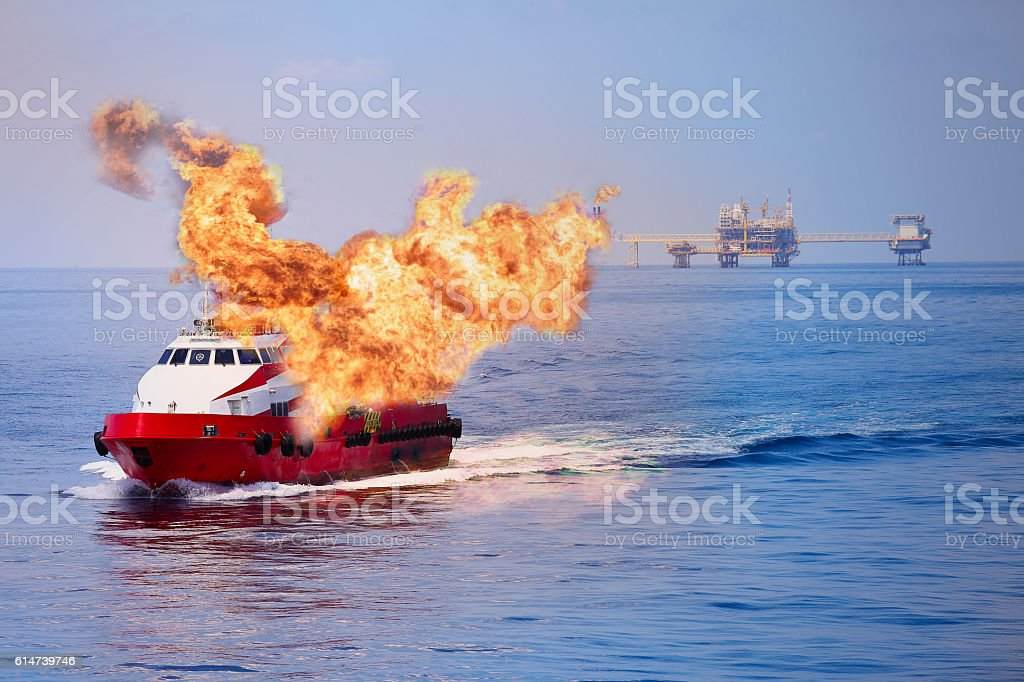 Fire burning on the boat in offshore oil and gas stock photo