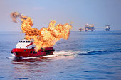 Fire burning on the boat in offshore oil and gas