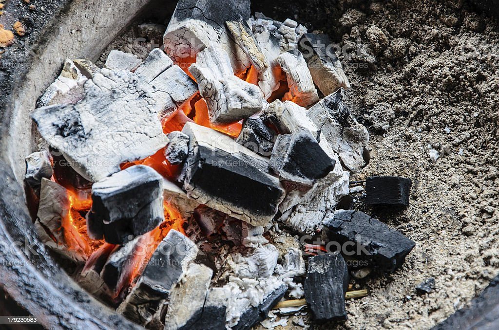 Fire coal in thai style stove royalty-free stock photo