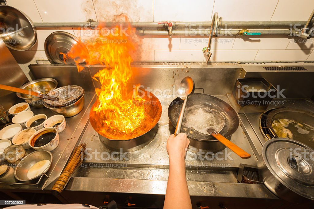 Fire cooking with chef stock photo