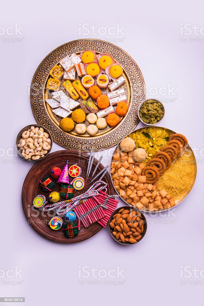 fire crackers and sweet food in diwali festival stock photo