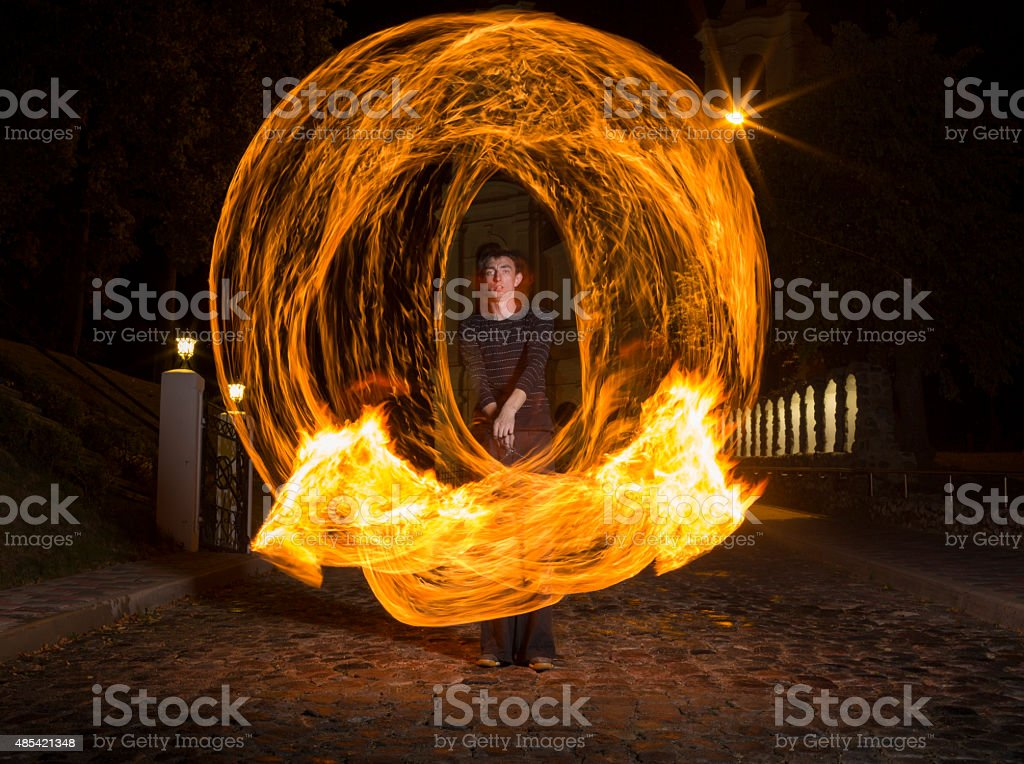 Fire dancer at night stock photo