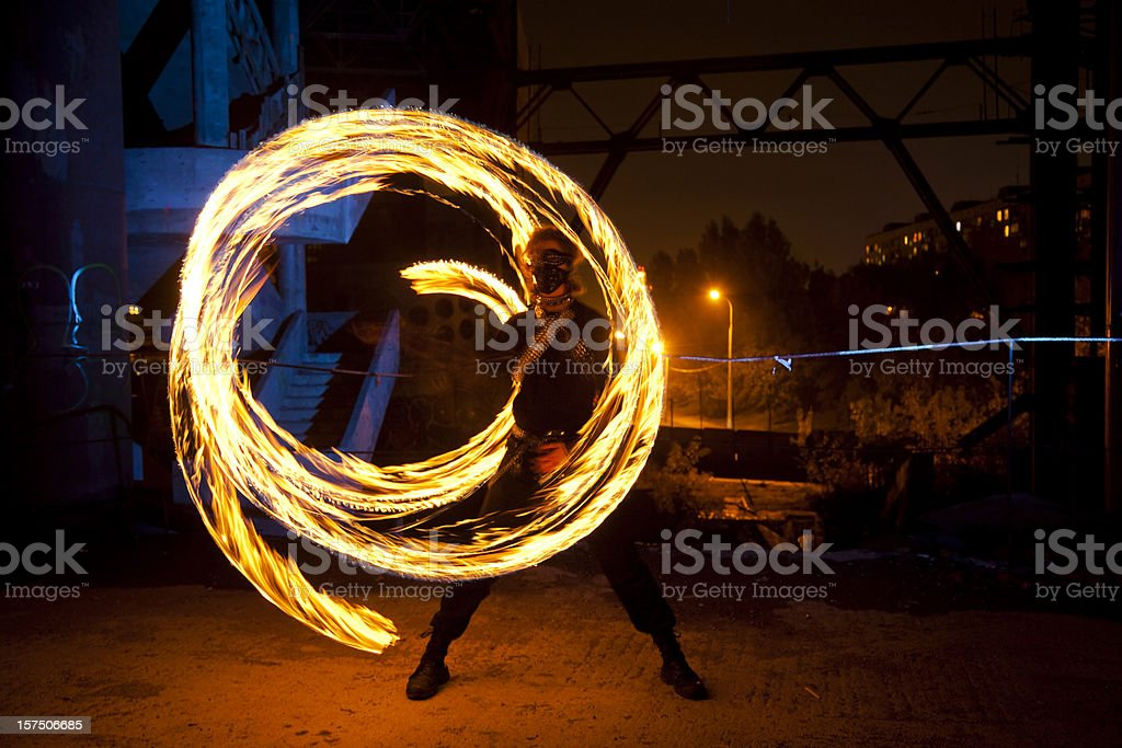 Fire Dancer in abandoned building stock photo