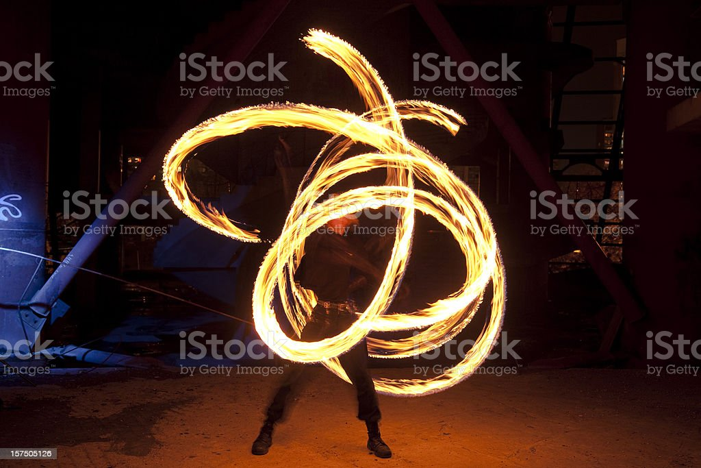 Fire Dancer in motion stock photo