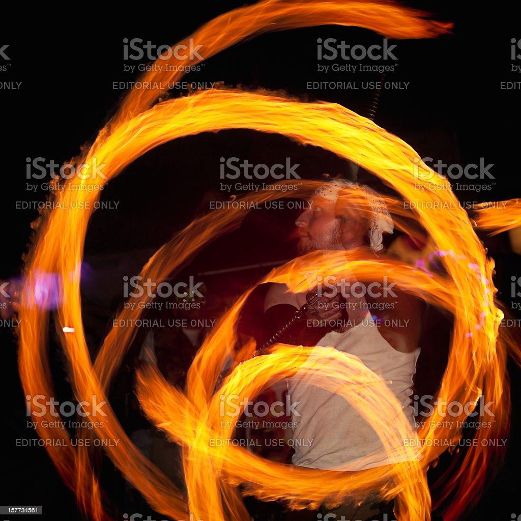 Fire Dancer Spinning Poi stock photo