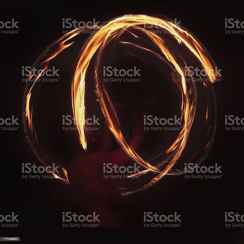 Fire Dancer - Spinning Poi stock photo