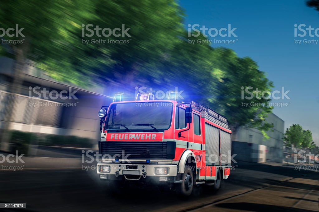 Fire Department driving with blue light stock photo