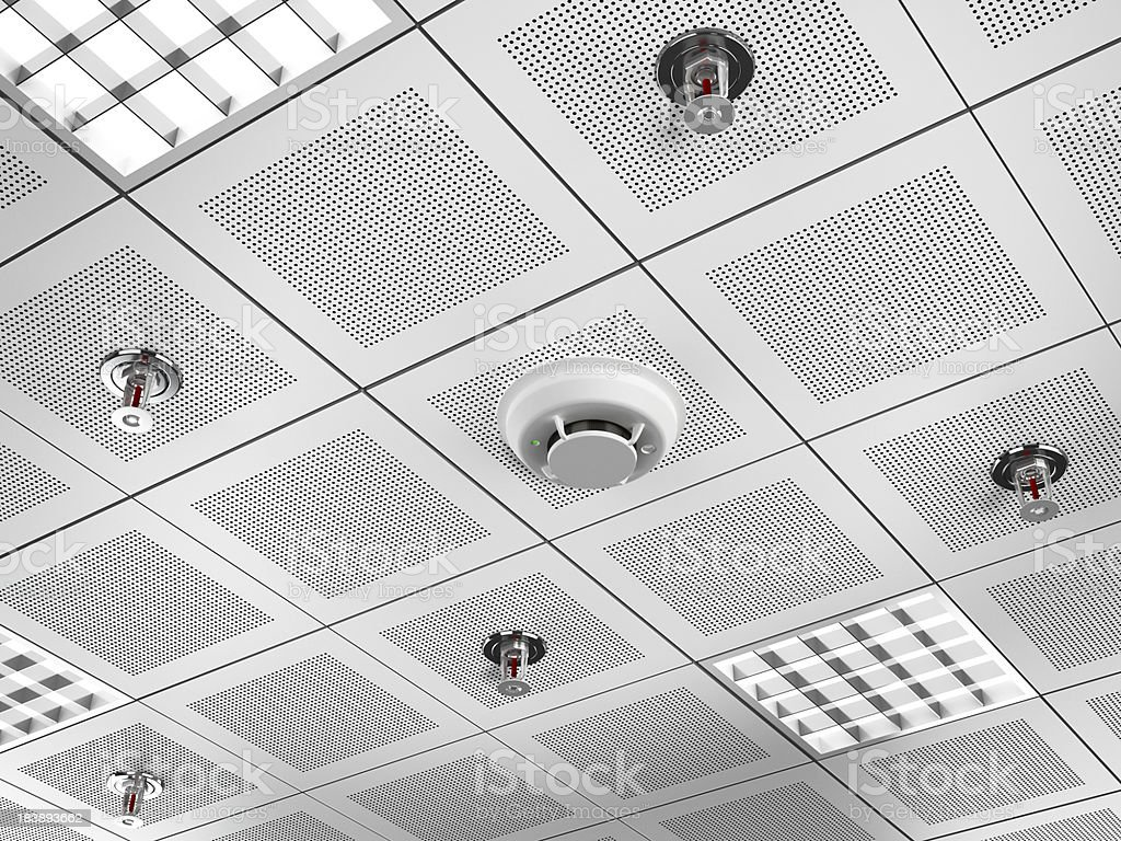 Fire detector and sprinklers stock photo