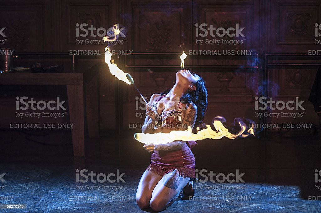 Fire eater playing with flames stock photo