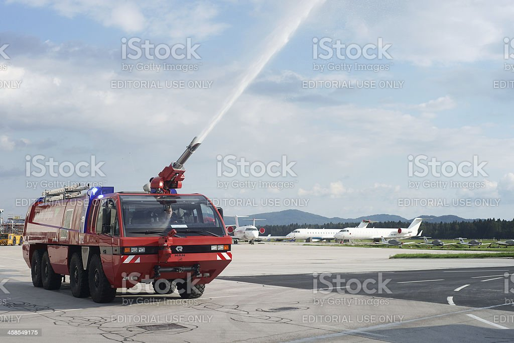 Fire engine at airport performing drill stock photo