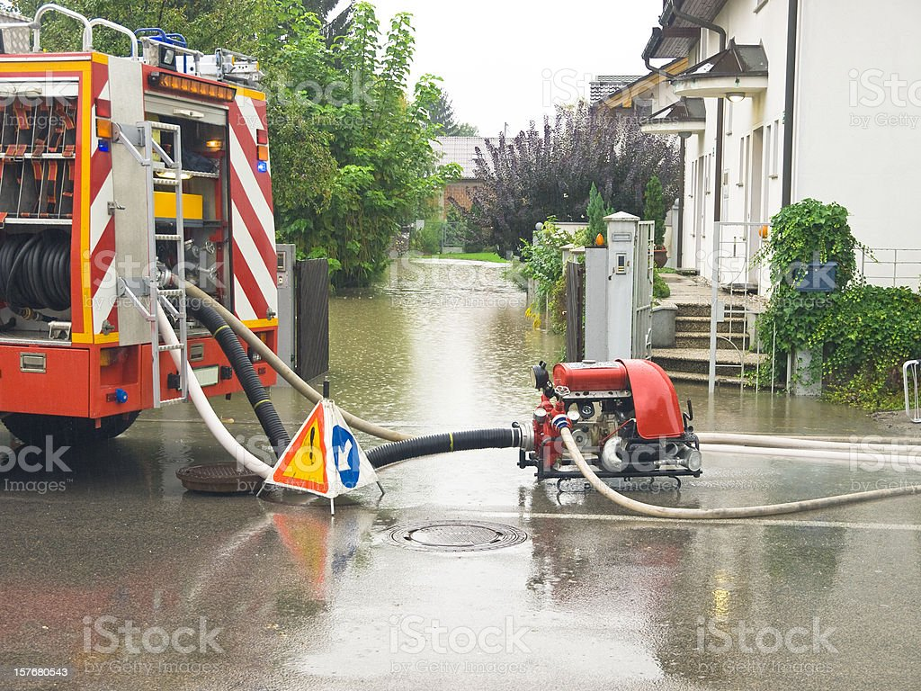 Fire engine at work pumping water royalty-free stock photo