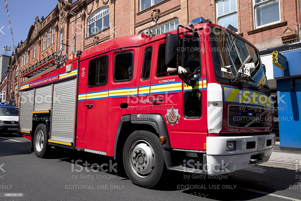 Fire engine in town centre stock photo