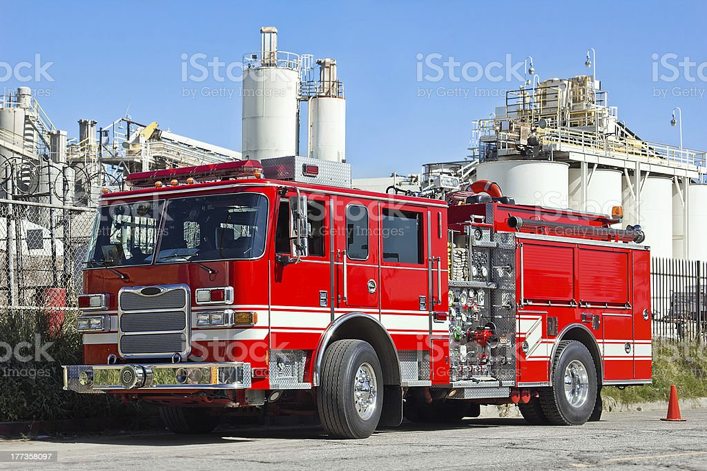 Fire engine parked by an industry site stock photo