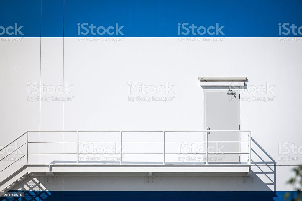 Fire escape stairs and Door outside of a the warehouse stock photo