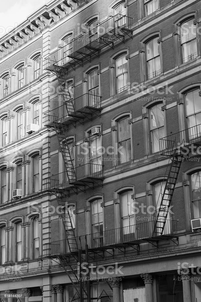 fire escape stairs in ny in black and white stock photo
