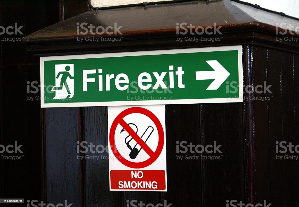 Fire exit and no smoking sign stock photo